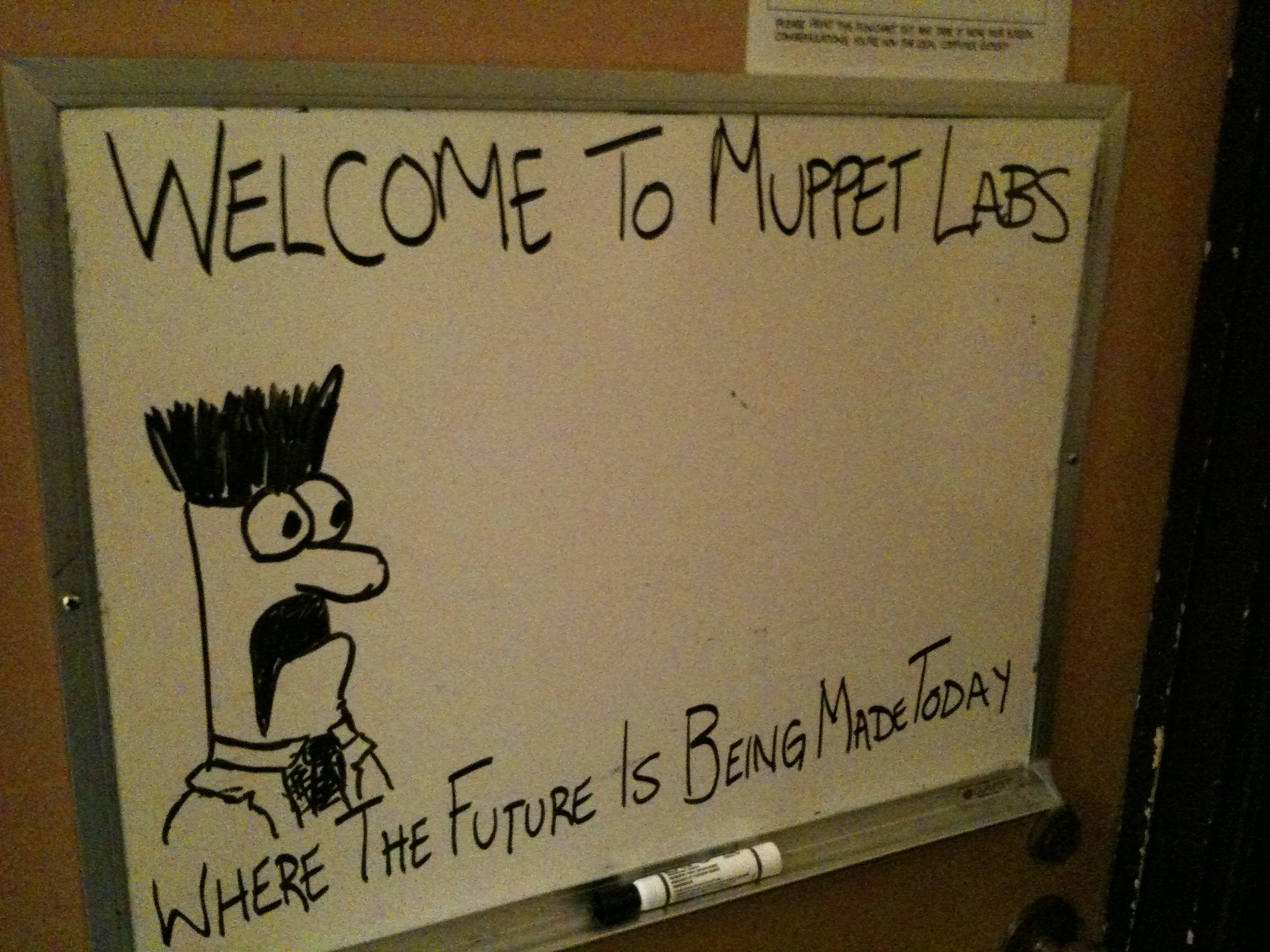 White board drawing of Beaker welcoming you to Muppet Labs