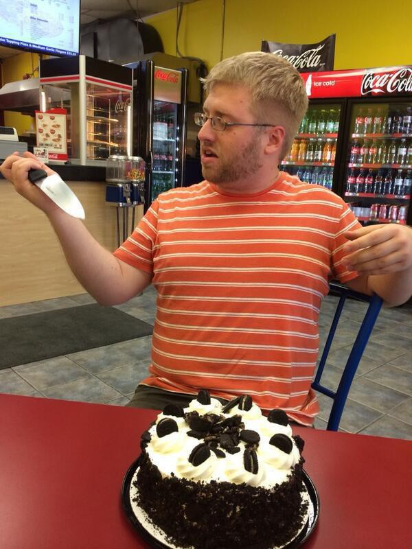 Colin with a cake and unreasonably large knife in Jessy's Pizza