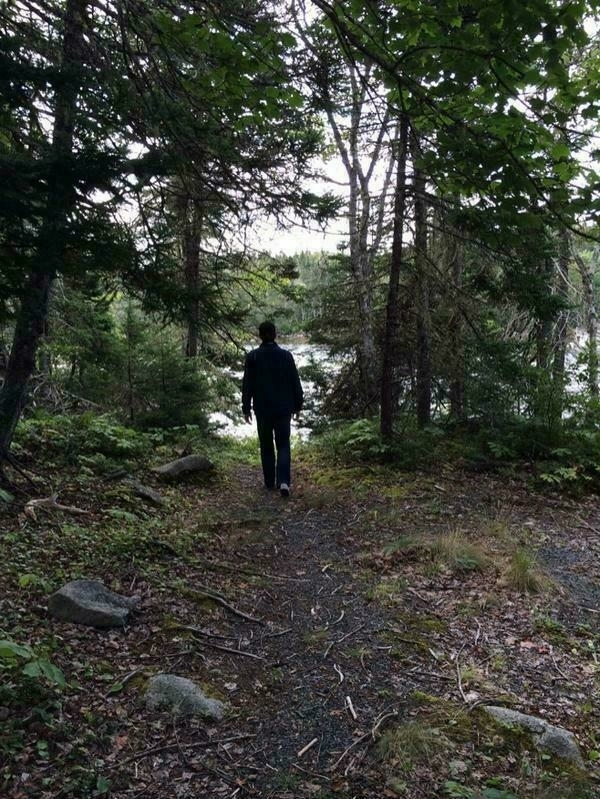 Me walking through the woods to the Canoe launch at the old Bayside Camp property