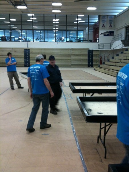 Competition tables being setup in the Acadia Gym