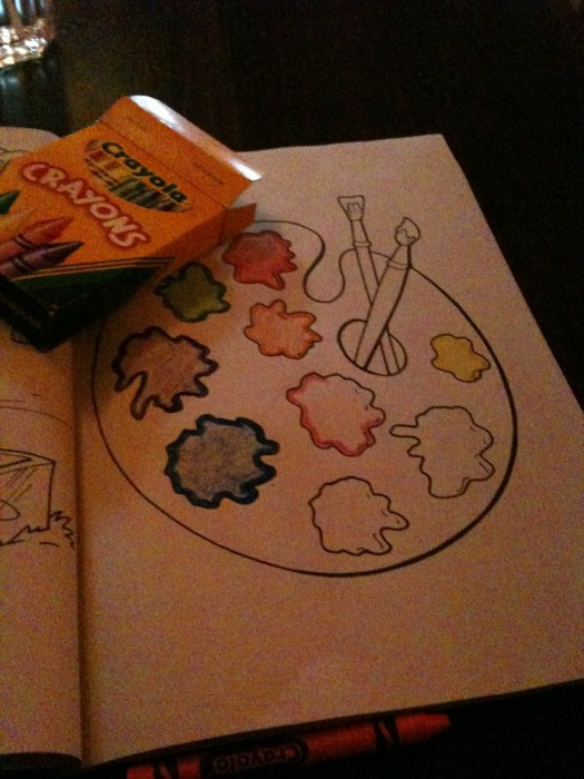 colouring book and a box of crayons