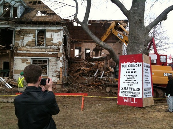 Demolition of an old white house