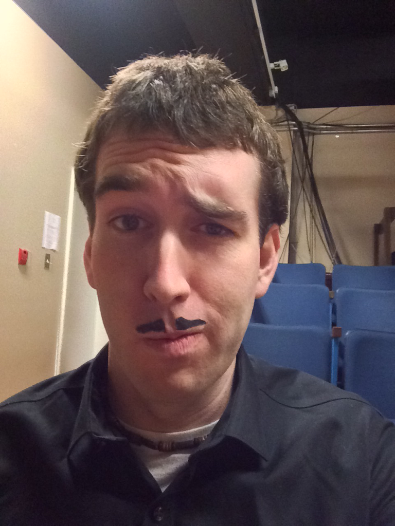 James with a fake fancy mustache drawn on his face
