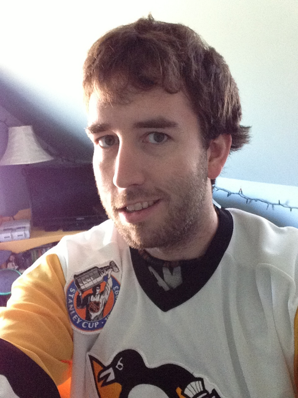 me wearing an early 90's Penguins jersey with a thin thin thin beard