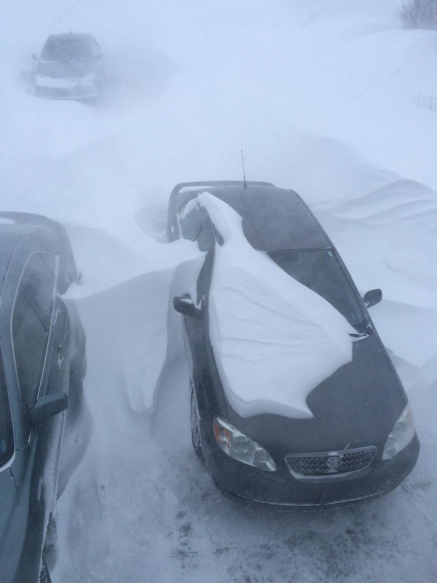 Top down view of snowbanks all around my car and higher than the car.