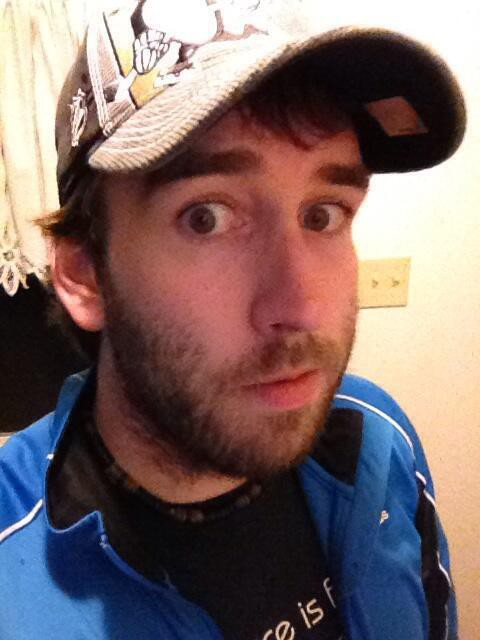 me wearing a Penguins hat showing off my playoff beard