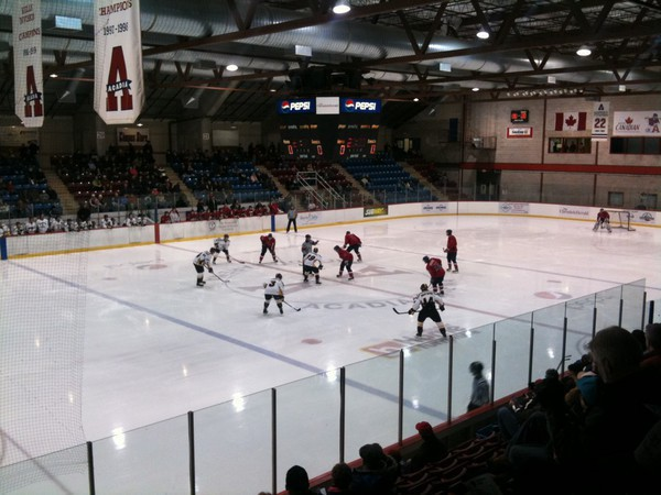 Opening faceoff of a hockey game in Acadia Arena