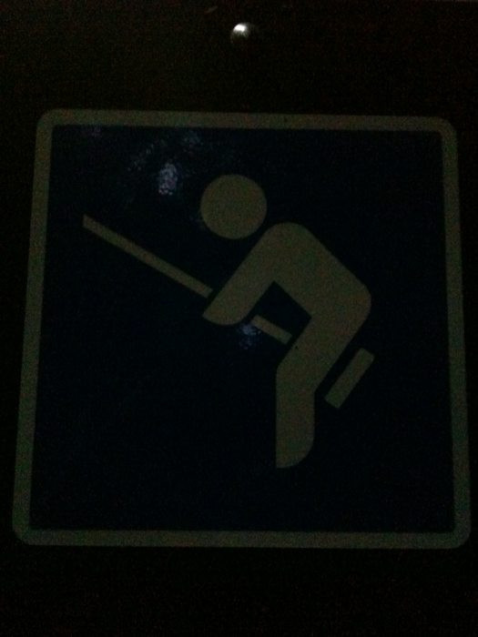Amusing stick figure sign
