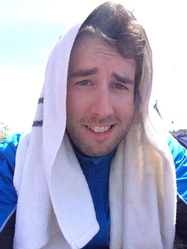 me sitting in the sun with a towel over my head