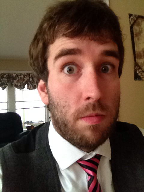 me wearing a shirt a tie while showing off a playoff beard