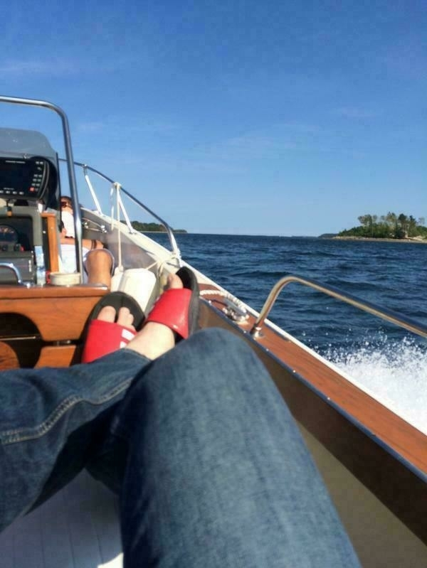 My feet up on the rail of a power boat