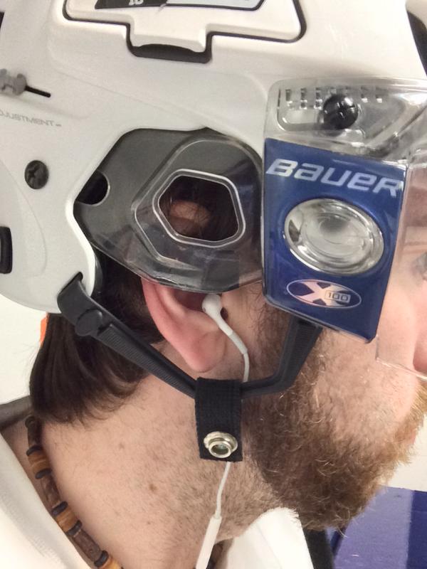 Headphone cable running up under a hockey helmet